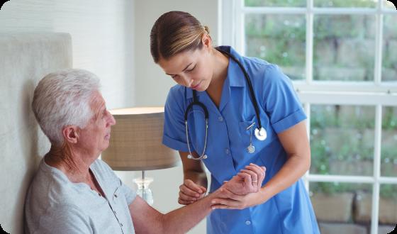 nurse-examining-senior-man